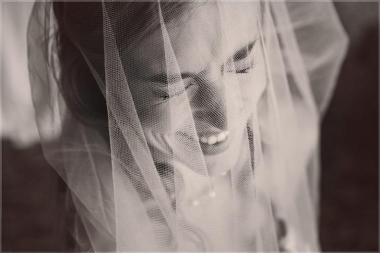 giggling bride behind veil